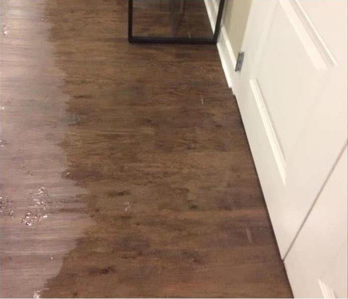 Wooden floor covered with flood water