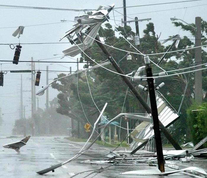 A structure being destroyed by hurricane storm winds